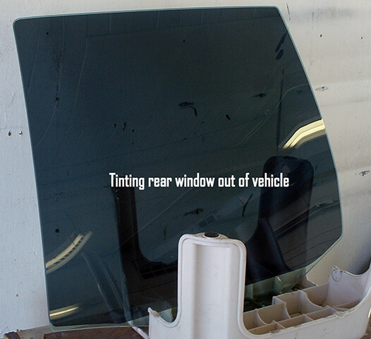 Tinting rear window of vehicle